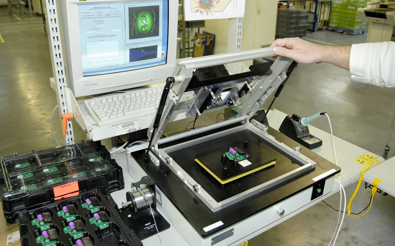 Assembly of electronic components, plastic overall, manual ...